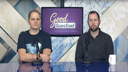 """Curtis and Chris sit at the anchor desk, a screen with the """"Good Question!"""" logo between them."""