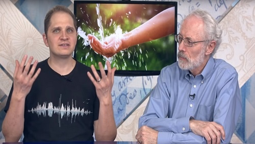 Curtis and Jonathan sit at the anchor desk, an image of a stream of water splashing on a hand behind them.