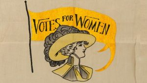 "An illustration of a ""Votes for Women"" suffragette sign"